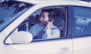 man on carphone while driving