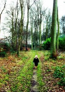 Boy walking in woods alone